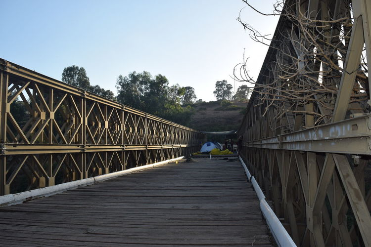 Adult Adults Only Architecture Bridge Bridge - Man Made Structure Camping Minimal Architecture Elevated Walkway Footbridge Geometric Shape Geometry Leading Lines Lines And Shapes Nature One Man Only One Person Outdoors People Railing Sky Staircase Tranquility Travel Photography Traveling Wooden Bridge