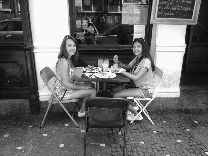Sitting Looking At Camera Portrait Full Length Smiling Two People Happiness Drink Togetherness Young Women Celebratory Toast Table Cheerful Chair Friendship Food Young Adult Drinking Glass Meal Eating EyeEmNewHere