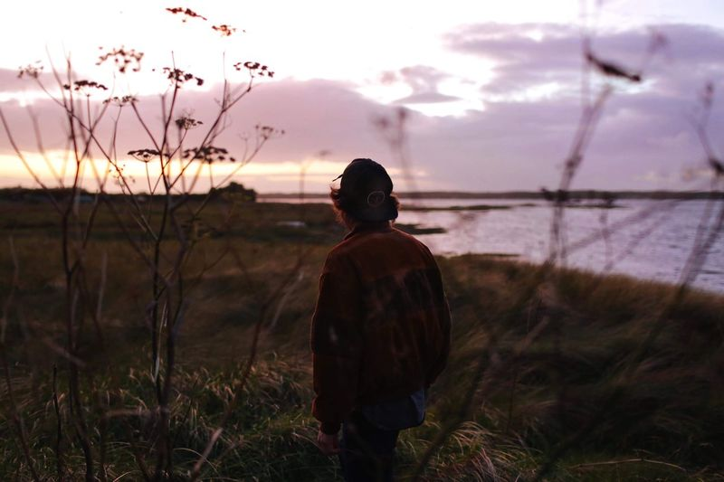 Sky One Person Real People Rear View Plant Leisure Activity Lifestyles Land Standing Nature Field Cloud - Sky Beauty In Nature Sunset Casual Clothing Tranquility Outdoors
