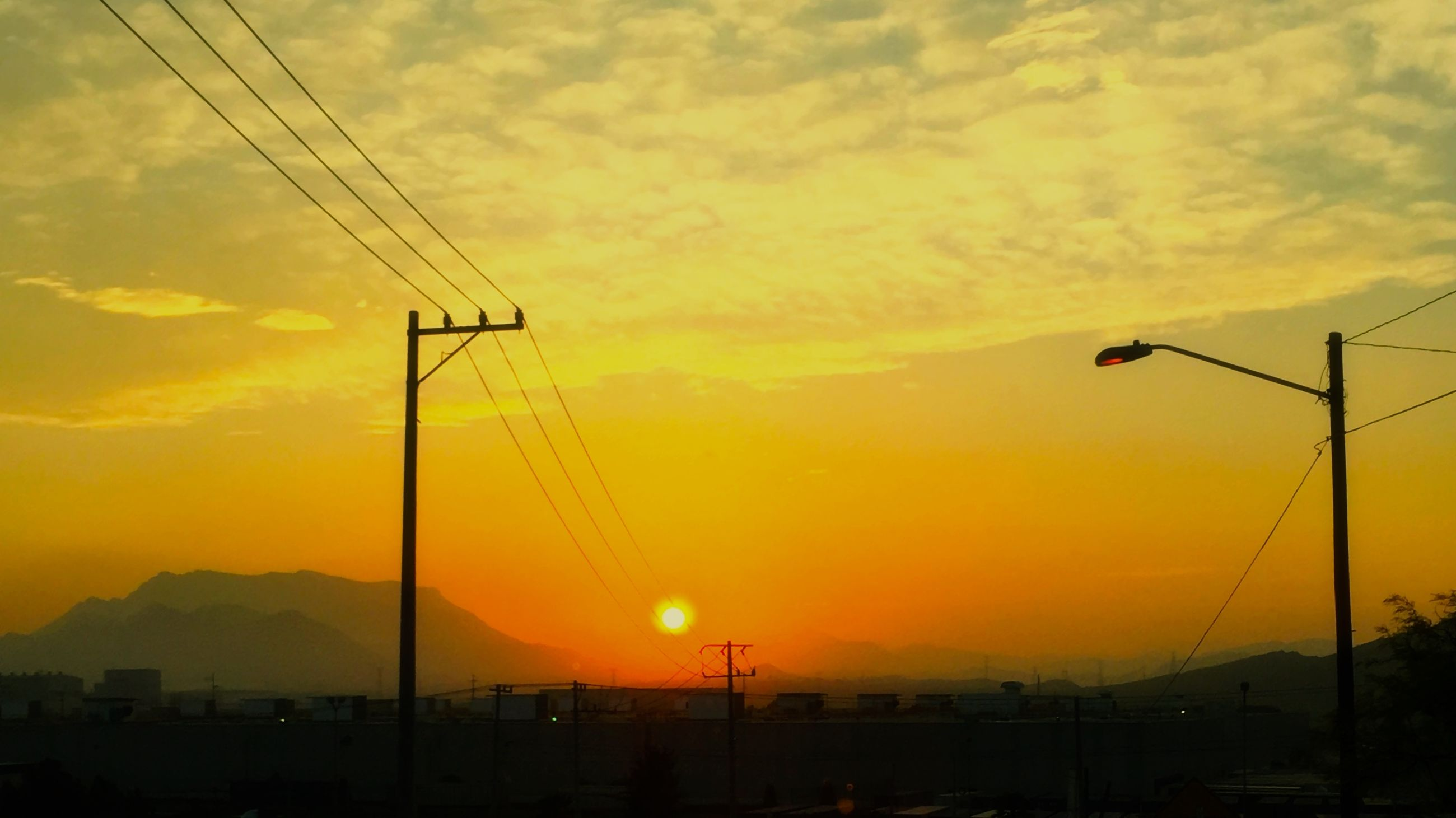 sunset, orange color, silhouette, electricity pylon, sky, power line, scenics, fuel and power generation, electricity, beauty in nature, power supply, tranquility, tranquil scene, technology, nature, idyllic, cloud - sky, connection, landscape, sun