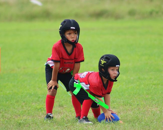 Brothers Boys Grass Headwear Two People Field Elementary Age Helmet Sports Clothing Playing Sports Helmet Children Only Sports Uniform The EyeEm Facebook Cover Challenge American Football Player Sports Team American Football Field The Week On EyeEm Team Sport Competitive Sport Sport From My Point Of View The Week Of Eyeem Competition Team This Is Family