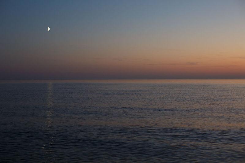 Sea Sky Water Scenics - Nature Horizon Over Water Beauty In Nature Horizon Tranquil Scene Waterfront Tranquility Sunset Idyllic Nature No People Moon Outdoors Non-urban Scene Dusk Clear Sky