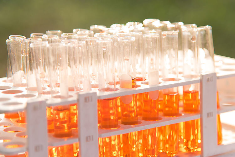 Lab science research glass items adding drop to one of several test tubes. A scientific experiment in a science research Laboratory. Medical Equipment Research Science Science Lab Glass Item Healthcare And Medicine Lab Laboratory Medical Medical Test Tubes