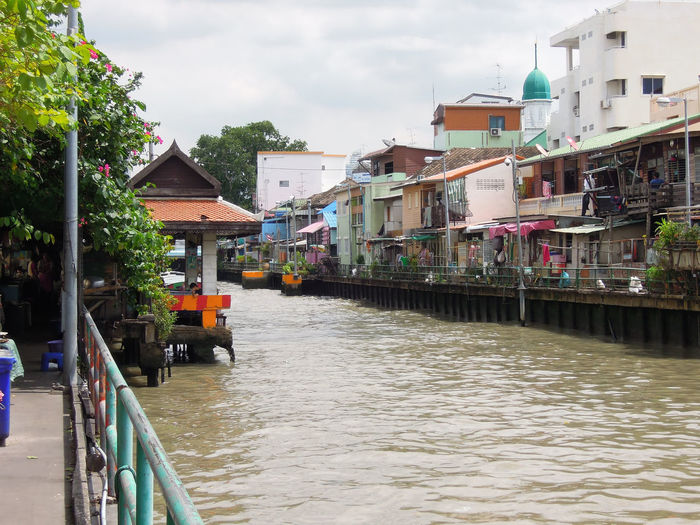 Narrow canal along buildings in town