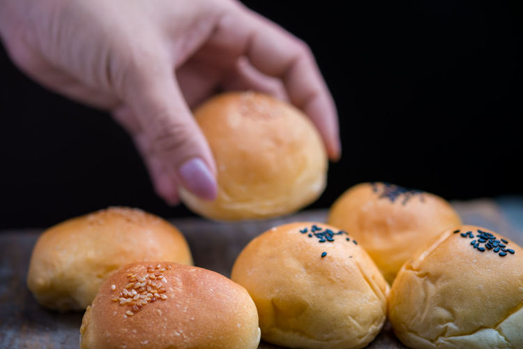 Close-Up Of Hand Picking Bread