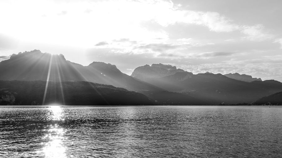 Lac d'Annecy early morning Ann Beauty In Nature Bright Cloud Cloud - Sky Landscape Lens Flare Mountain Mountain Range Nature No People Non-urban Scene Outdoors Scenics Sky Sun Sunbeam Sunlight Sunny Tranquil Scene Tranquility Water