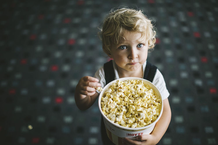 Portrait of girl eating popcorn