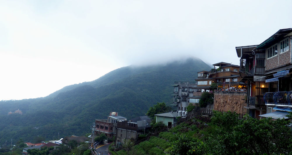 Foggy Day in Taiwan Taiwan Architecture Beauty In Nature Building Exterior Built Structure Day Fog House Mountain Nature Outdoors Scenics Sky Travel Destinations Tree