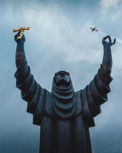 Statue and fly