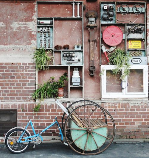Bicycle against wall in city