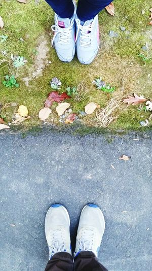 Worlds Apart Shoe Human Foot Personal Perspective Real People High Angle View Outdoors Sports Shoe Green And Grey Urban Forest