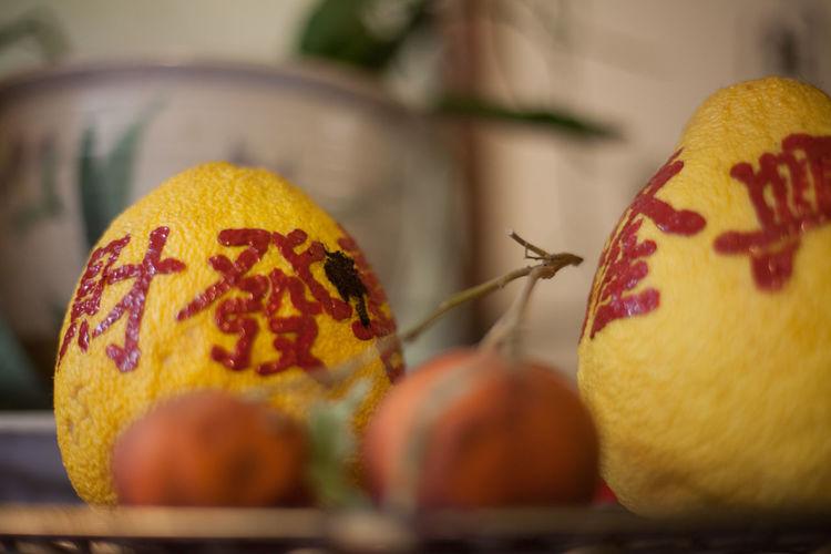 Chinese Script On Lemons