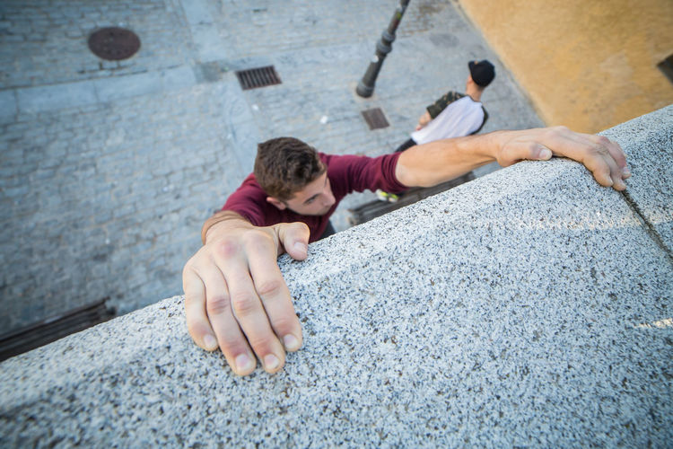 High Angle View Of Man Climbing Wall