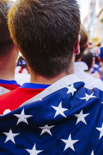 Rear view of man with american flag at event
