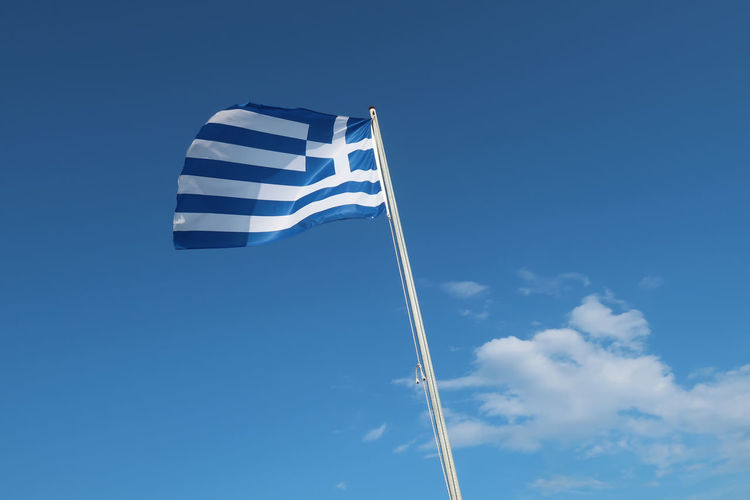 Flag of Greece Sky Blue Travel Flag Tourism Sunlight Waving Patriotism Greece Pride Symbol National Patriotic Nation Pole Striped Hellas GREECE ♥♥ Ellada  Greek Flag Politic White Color Tourism Destination Travel Destinations National Icon Wind Cloud - Sky Day No People Environment Outdoors
