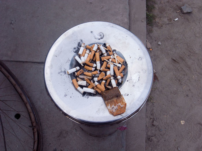 Directly Above Shot Of Cigarette Butts In Ashtray