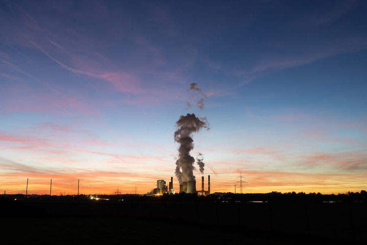 Kraftwerk RWE Power Air Pollution Architecture Atmospheric Built Structure Cloud - Sky Ecosystem  Emitting Environment Environmental Issues Factory Fuel And Power Generation Germany Industry Nature No People Orange Color Outdoors Pollution Silhouette Sky Smoke - Physical Structure Smoke Stack Sunset