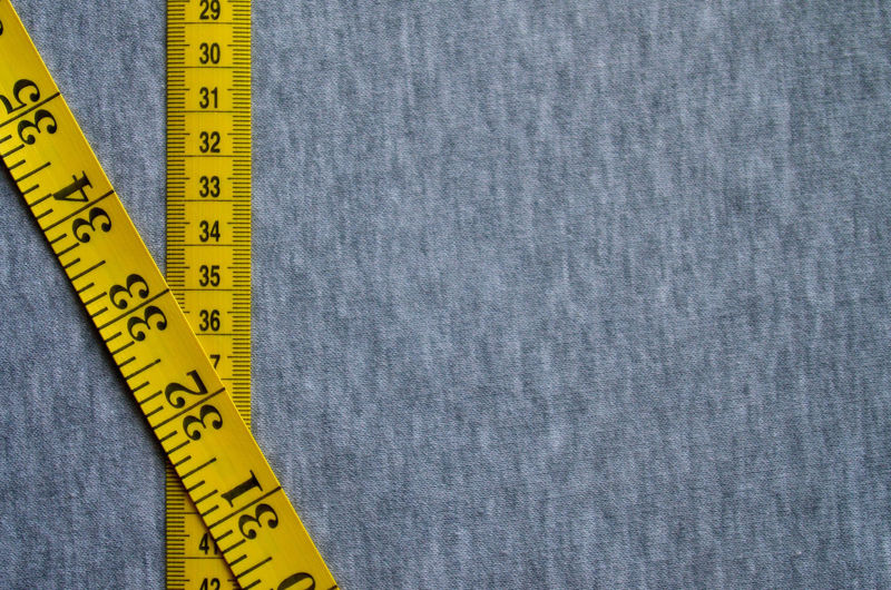 Close-up of tape measure on textile