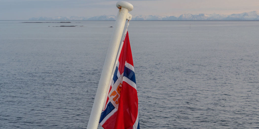 en route pour Sortland Atlantic Ocean Coastline Hurtigruten Morning Light Norge Norwegian Sea Vesterålen Winter Beauty In Nature Flag Focus On Foreground Island Nature Outdoors Polar Circle Scenics Sea Ship Snow Tranquility Water