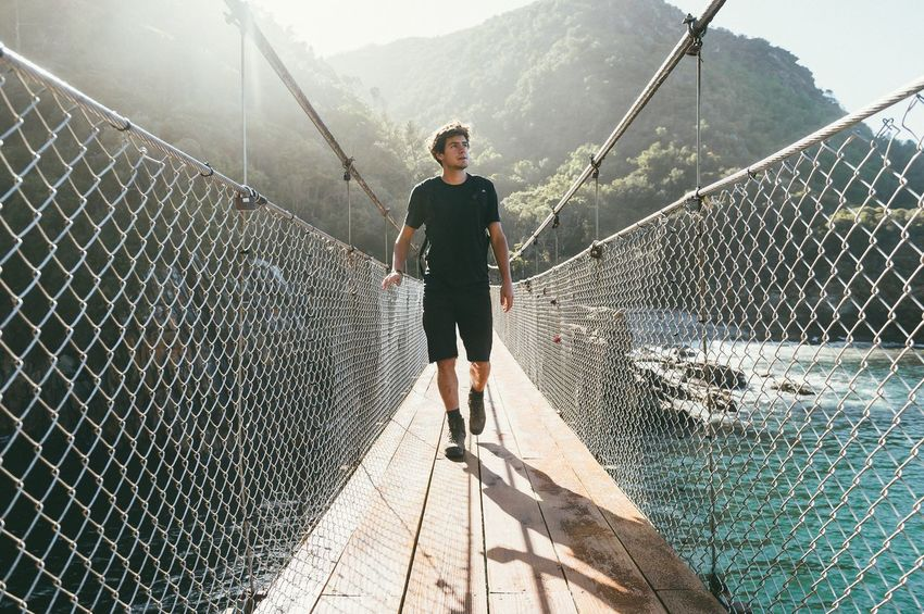 Tsitsikamma Mouth Tsitsikamma National Park Tsitsikamma Suspension Bridge Chainlink Fence Full Length Outdoors Casual Clothing Sunlight One Person Real People