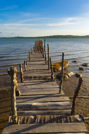 Backgrounds Bridge - Man Made Structure Wooden Wood - Material Jetty Adventure Day Travel Destinations Sunlight Seascape Freshness Landscape Perspective Outdoors Golden Hour Water Sea Beach Sand Nautical Vessel Low Tide Fishing Ancient Sunset Sky Ancient Civilization Railway Bridge Footbridge