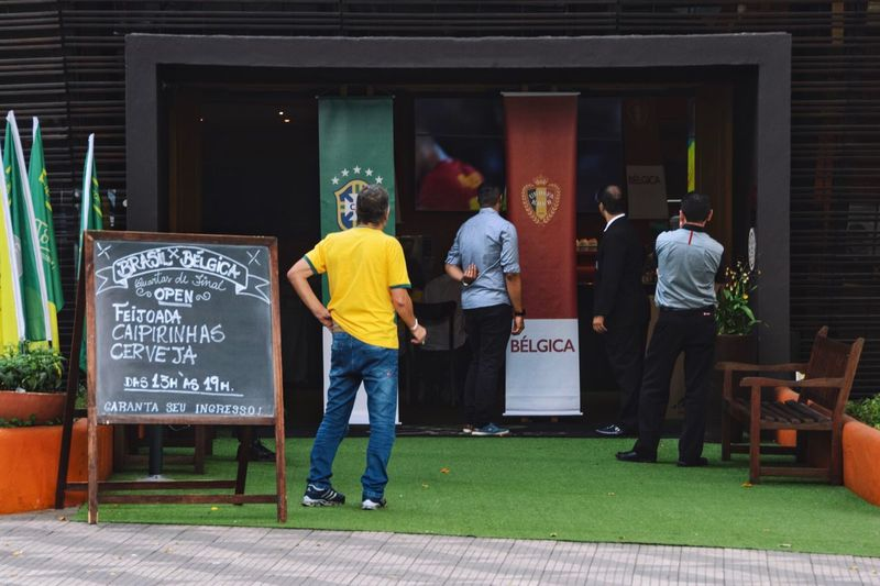 World Cup World Cup 2018 Togetherness Streetphotography Street Photography City Urban Soccer Full Length Architecture Group Of People Text Real People Built Structure Western Script People Communication Men Rear View Standing Grass Crowd Leisure Activity Lifestyles Outdoors Building Exterior The Street Photographer - 2018 EyeEm Awards Love The Game