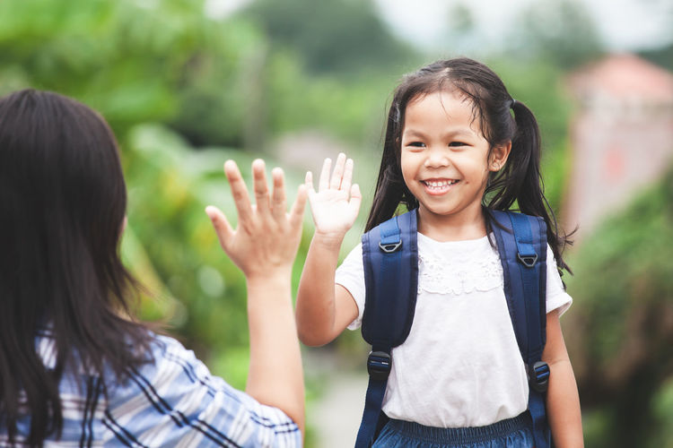 Back to school. Cute asian child girl with school bag and her mother making hi five gesture before go to school with fun Asian  Bye Bye Family Fun Happy Mother Student Back To School Backpack Bag Child Cute Enjoy Girl Hand Hi High Five Kid Knowledge Learn Parent Pupil School Smiling Study