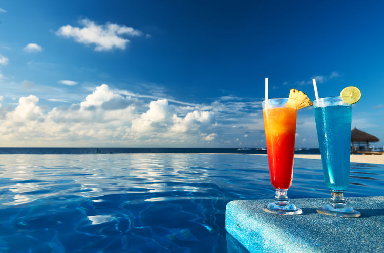 Alcohol Beach Blue Cloud - Sky Cocktail Drink Drinking Straw Horizon Over Water Idyllic Nature No People Outdoors Refreshment Relaxation Sea Sky Summer Swimming Pool Tourist Resort Tranquil Scene Travel Destinations Tropical Climate Tropical Drink Vacations Water