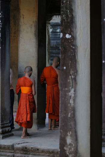 Monks walking in old temple
