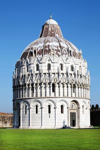 Pisa baptistery against blue sky