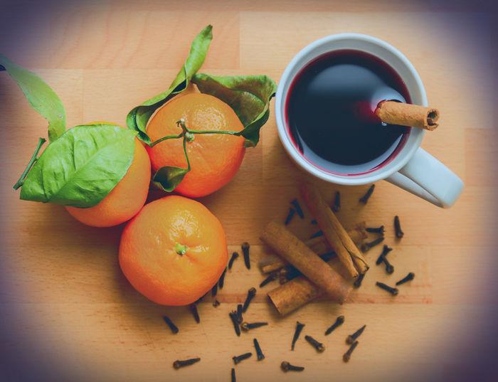 Mulled Wine Cinnamon Sticks Cloves Cup Directly Below Food And Drink Gluehwein Mandarin Oranges Mulled Wine Overhead View Preparation  Seasonal Spices Table Winter