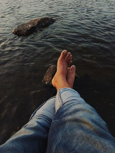 chilling EyeEm Eyeemindia Capture The Moment This Is My Skin EyeEm Selects Low Section Water Sea Beach Human Leg Relaxation barefoot Rippled Jeans Personal Perspective Rolled Up Pants Legs Crossed At Ankle Feet Human Feet Human Shore