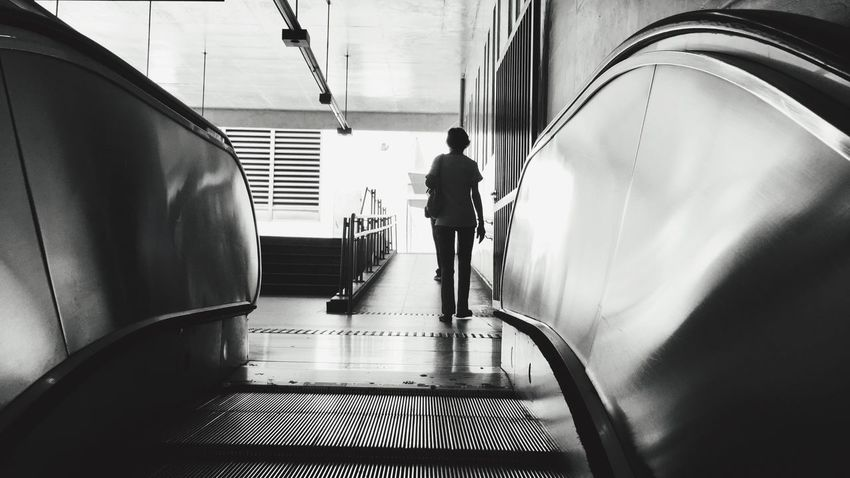Monochrome Photography Real People Railroad Station Modern Day Steps And Staircases Architecture Moving Walkway  Adult Grayscalephotography