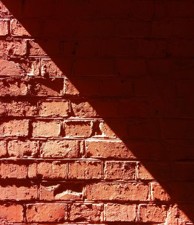 Sharp shadow Shadow Sharp Sun Light Brick Wall Red Backgrounds Full Frame Illuminated Brown Textured  Close-up Architecture The Architect - 2018 EyeEm Awards