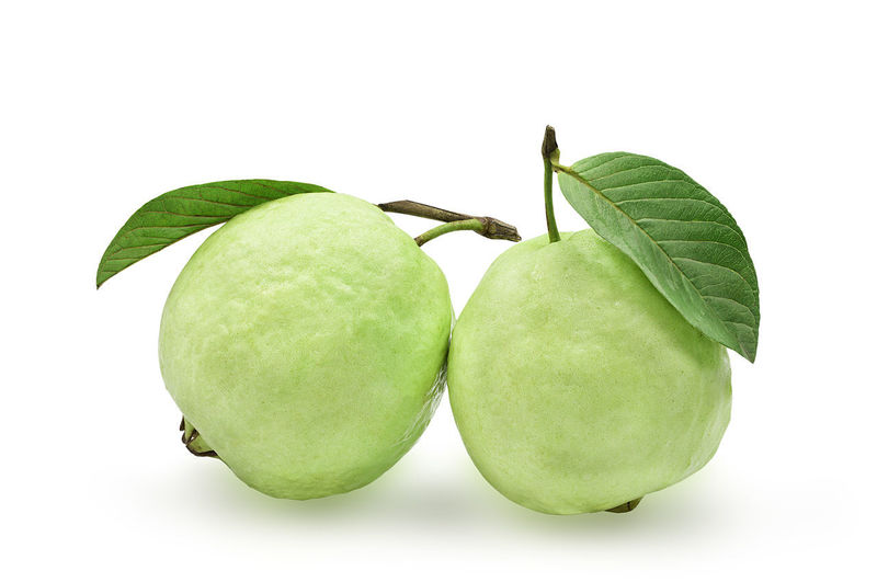 Close-up of fruits on white background