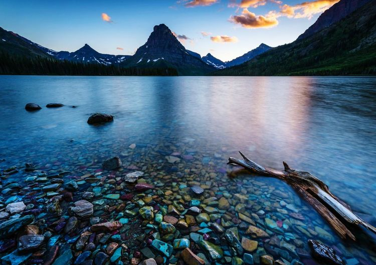 My first trip to Glacier National Park, Montana, rewarded me with stunning views everywhere! I was inspired to visit because of great photos that I'd seen, and the realization that the glaciers are receding, and may disappear in the near future. Water Sky Beauty In Nature Mountain Nature Scenics - Nature Tranquil Scene Tranquility Lake No People Blue Idyllic Non-urban Scene Land Mountain Range Day Reflection Cloud - Sky The Great Outdoors - 2018 EyeEm Awards