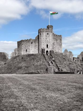 Cardiff Cardiff Castle Architecture History Sky Building Exterior Cloud - Sky Built Structure Castle Day Flag Fort Outdoors Low Angle View No People Travel Destinations Landscape Nature Tree Grass EyeEmNewHere