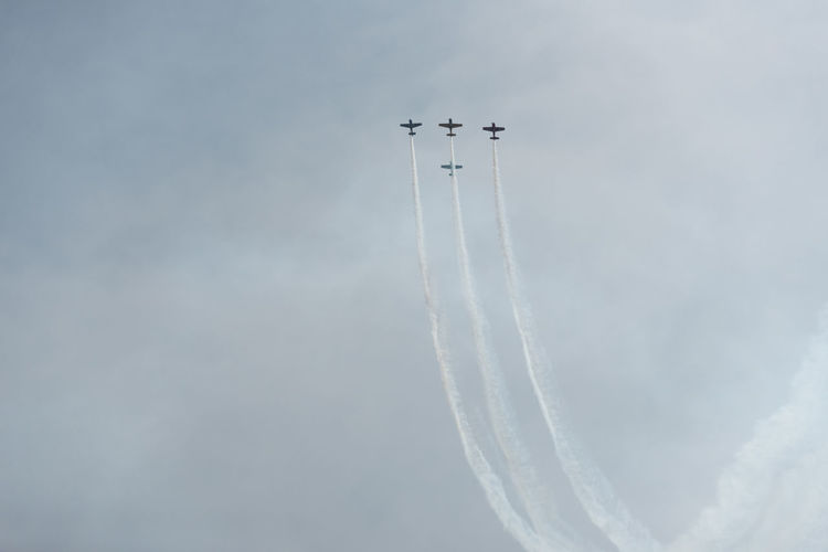 Low Angle View Of Airplanes Flying Against Sky During Air Show