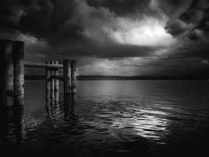 Water Cloud - Sky Sea Sky Beauty In Nature Tranquil Scene Tranquility Scenics - Nature Waterfront Nature Horizon Horizon Over Water No People Pier Post Wood - Material Storm Outdoors Wooden Post