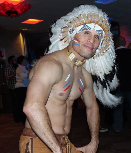 The Portraitist - 2016 EyeEm Awards Native American from the Village People at the Worlds Largest Disco 2015. Man Headdress Feathers Bare-chested Fun Handsome Man