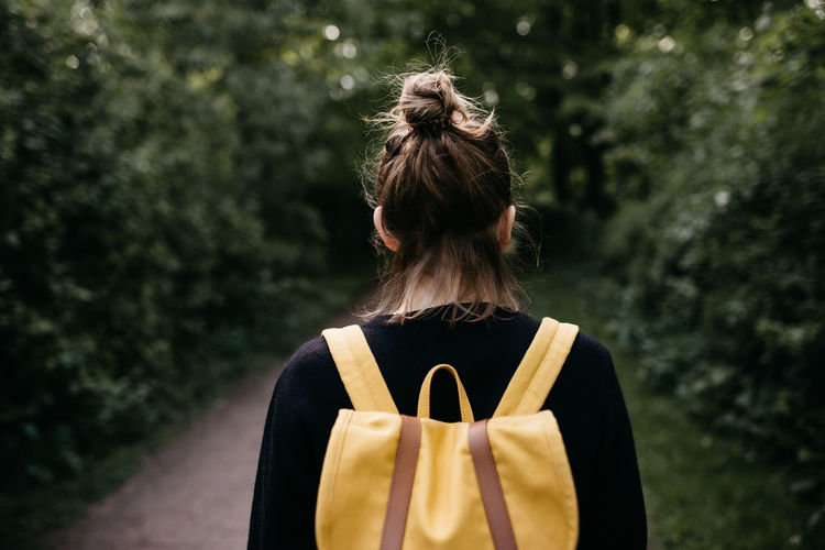 Adult Adults Only Bag Day Focus On Foreground Hair Bun Hamburg One Person Outdoors People Real People Rear View Tree Women Yellow Bag Yellow Rucksack Young Adult