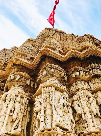 TEMPLE 🙏🏼 Stone Carved Temple Stone Carving Stone Carving Gujarat Incredible India Indian Architecture Sky Architecture Low Angle View Built Structure Day Cloud - Sky History Travel Destinations Religion Art And Craft Creativity Outdoors Building Exterior Craft Travel Nature No People The Past Flag Building