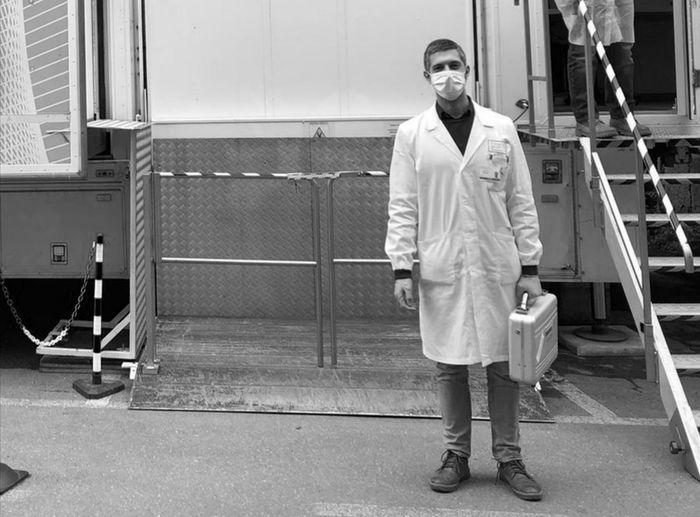 Portrait of doctor standing outdoors
