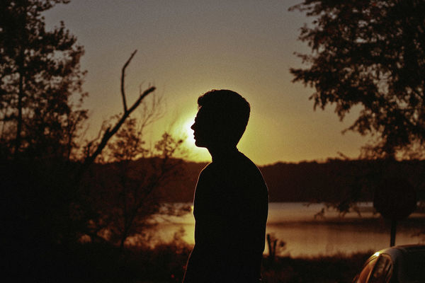Sunset, 2018 Nature Sunlight Sunset Silhouettes Beauty In Nature Contemplation Field Focus On Foreground Lake Leisure Activity Lifestyles Men Nature One Person Outdoors Plant Real People Side View Silhouette Sky Standing Summer Sunset Tree Waist Up Women A New Beginning