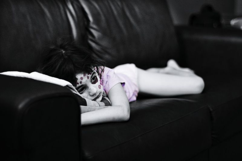 Portrait Of A Child Lying On Sofa