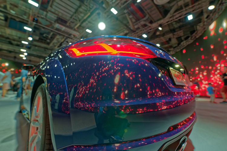 Reflections Low Angle View PENTAX K-1 Alloy Wheels Bokeh Focus On Foreground Audi Auto Union Tt Reflection Auto Show Automobile Car Blue Red Tail Light Pentax Pentax 15-30 F/2.8 Wide Angle Dxo City Business Finance And Industry Multi Colored Illuminated Car Light Trail