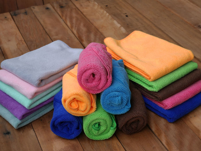 High Angle View Of Colorful Towels On Wooden Floor