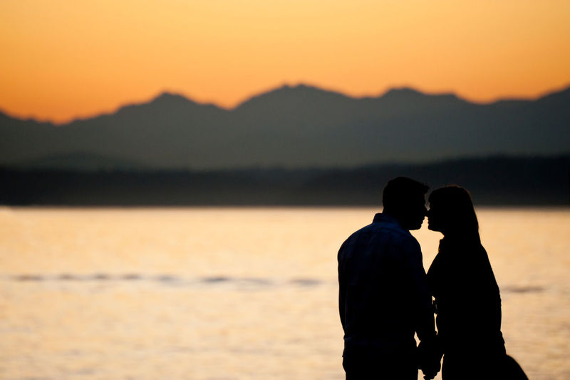 Some Enchanted Evening... A couple stops to enjoy a Seattle sunset with the Olympic Mountains and Bainbridge Island in the background. Kiss Seattle Sunset_collection Washington Adult Bainbridge Island Bonding Couple - Relationship Emotion Heterosexual Couple Love Nature Olympic Mountains Outdoors People Positive Emotion Romance Scenics - Nature Silhouette Sky Standing Sunset Togetherness Two People Water