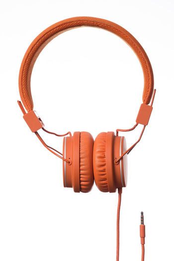 Orange Headphones on white Background Cable Close-up Day Headphones No People Product Product Photography Sound Studio Shot Technology White Background