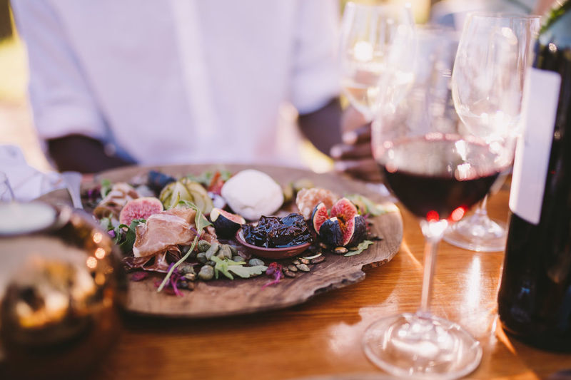 Food And Drink Food Freshness Midsection Table One Person Selective Focus Indoors  Business Ready-to-eat Close-up Vegetable Real People Restaurant Healthy Eating Meat Meal Glass Drink Men Dinner Red Wine Winefarms